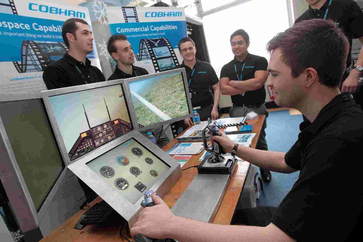 THE SIM: Cobham representatives with their simulator at the Find Your Future in Dorset 2014 recruitment and skills exhibition