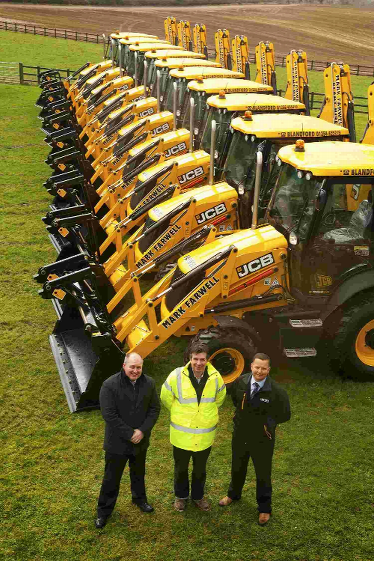 TOP GEAR: From left, Dave Probert, of dealer Holt JCB, company owner Mark Farwell and Richard Davis of Holt JCB