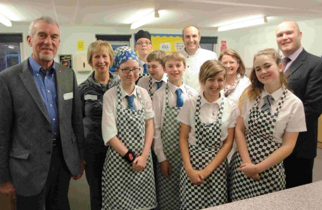 Christchurch Rotary president David Crumpler, Mary Reader, of the Christchurch Food Festival Education Trust, Ian Hewitt, Christine Emery, of Grange School, and Grange headteacher Steve Dossett with Year 10 students