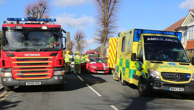 Woman trapped in car after two-car crash in Charminster