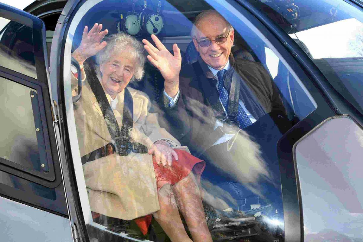UP, UP AND AWAY: Hilda Baybutt celebrates her 106th birthday in style as she boards a helicopter with her son Nick at Spetisbury Manor. Pic: Sally Adams