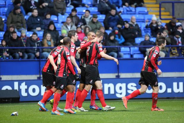 DELIGHT: Cherries celebrate Simon Francis's goal at the Reebok this afternoon