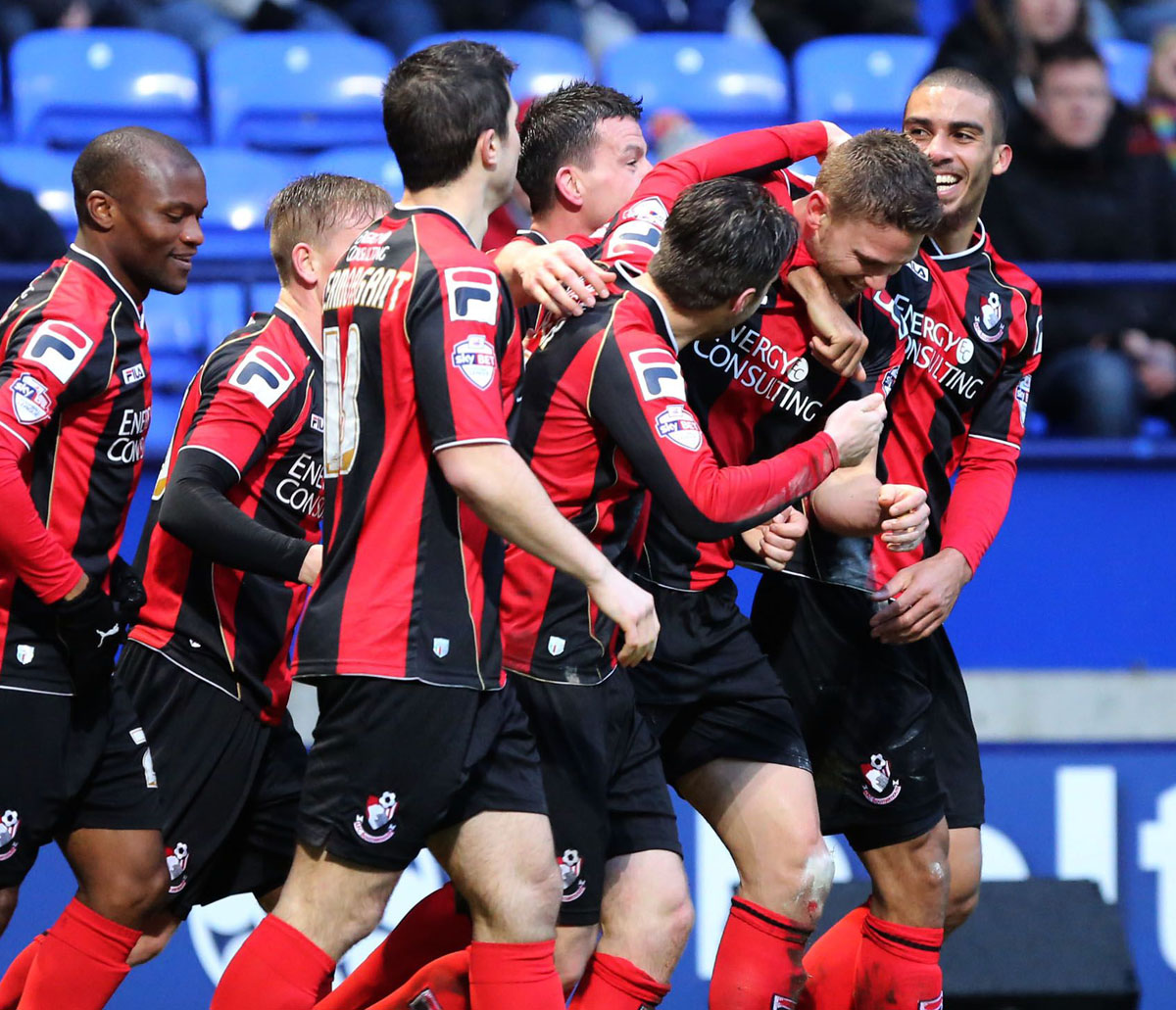 EQUALISER: Simon Francis is mobbed by team-mates after his goal