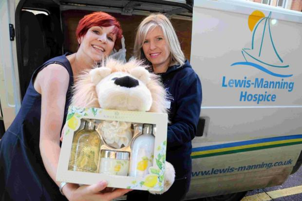 WIN-WIN: The Echo's Kathy Dexter and  Sally Goodenough, of Lewis-Manning Hospice, load up donations from Echo staff
