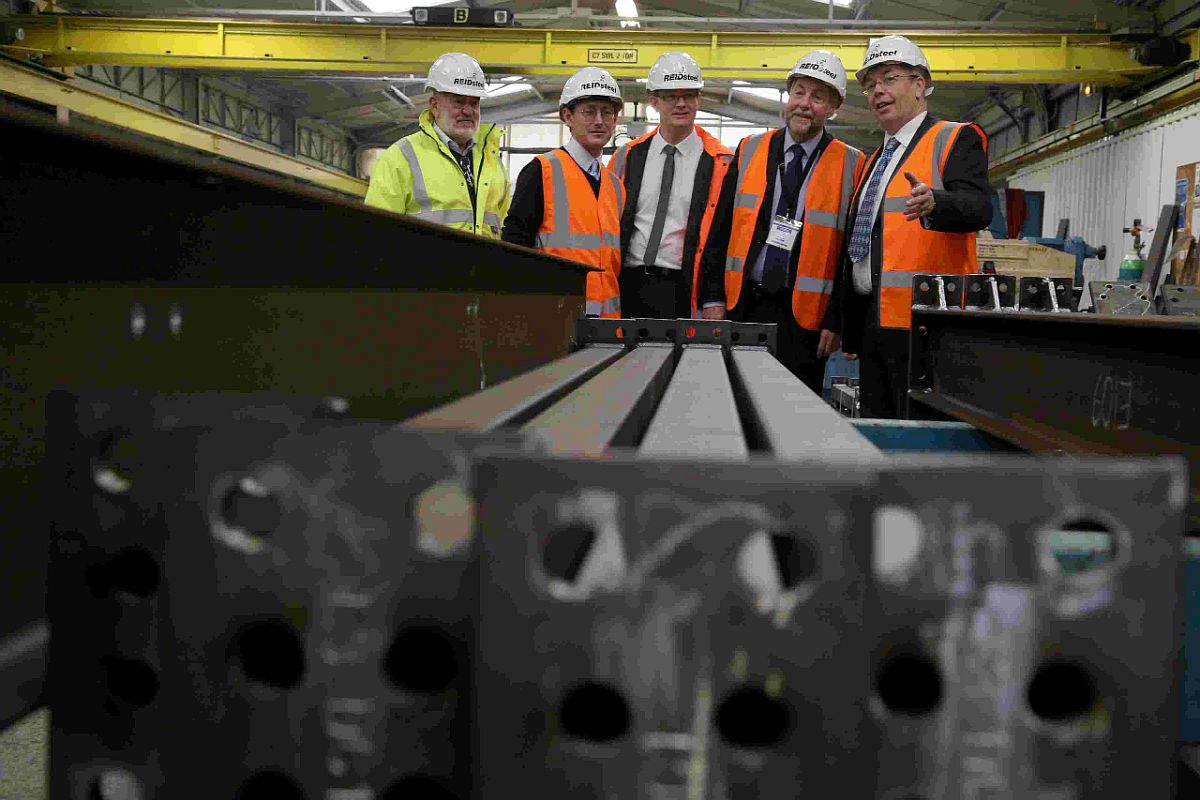 ON TOUR: Contracts director Simon Boyd, right, shows Denver Woodward, chairman of the Steel Construction Certification Scheme, around the site