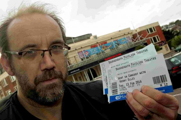 SHOCKED: Andy Walker, 42, with the tickets he picked up from the Pavilion box office after learning of a £1 charge to print them off himself
