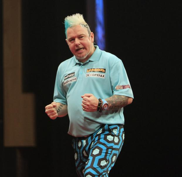 Bournemouth Echo: COLOURFUL: Peter Wright in action at the BIC tonight