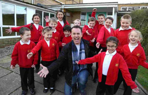 BRIGHT SPARK: CBeebies' Chris Jarvis meets pupils from Elm Academy