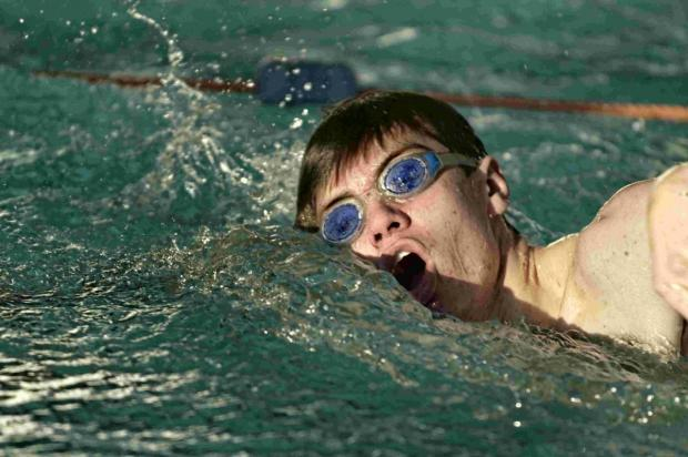 IN THE SWIM: Relay swimmer in charity fundraiser