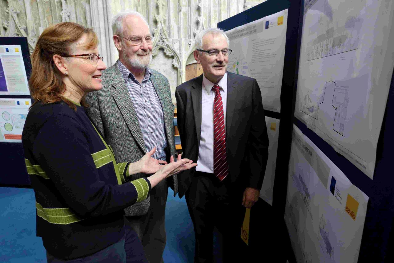 From left, Jennie Schillig of architects Columba Cook, parish development manager Mike Beams and Cliff Lane of Savills look at plans for a new hall at Christchurch Priory