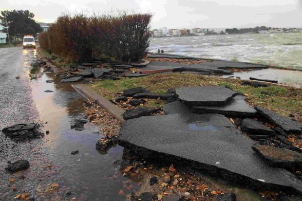 Work starts on pavement in Shore Road ripped up by violent storms