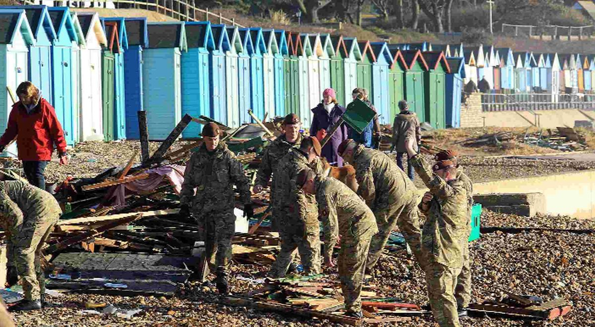 Army called in after hundreds of beach huts smashed to pieces by storm