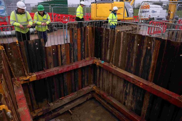 HOLE STORY: Wessex Water staff at the burst sewer on Blandford Road and, inset, project manager Andy Gale
