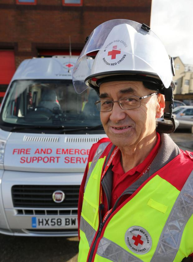 Bournemouth Echo: Red Cross volunteer Peter Robinson with the Fire and Emergency Support vehicle