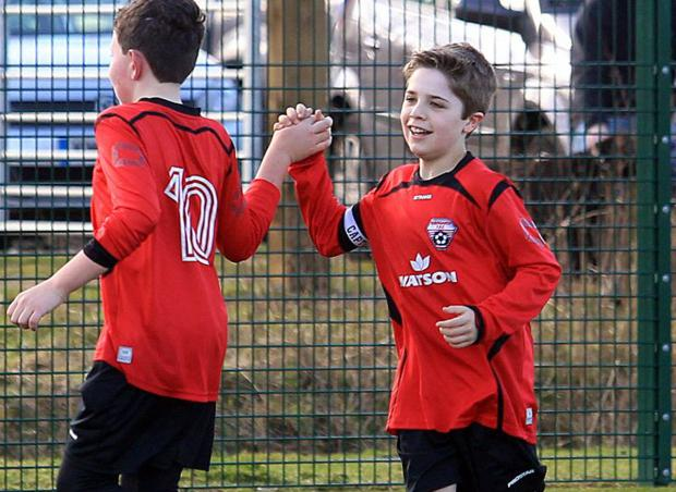 REDS RULE: Rossgarth celebrate one of their goals at Potterne Park