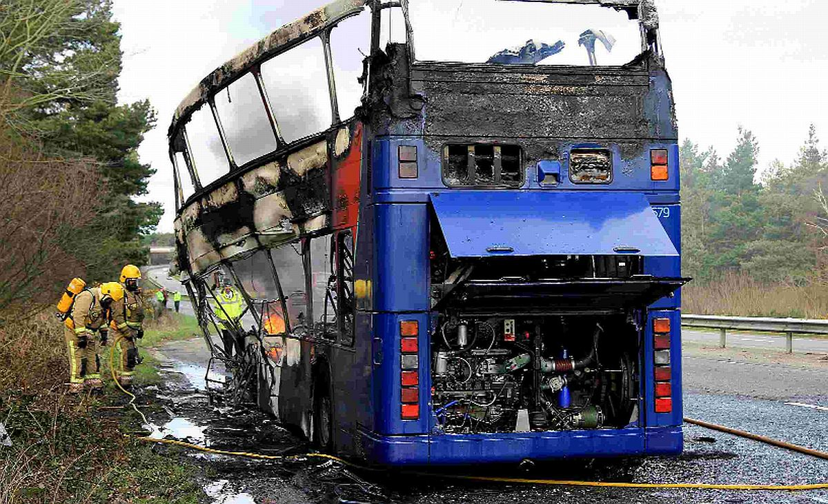 ELECTRICAL FAULT: Fire fighters at the scene of the double decker bus fire on the A338 northbound