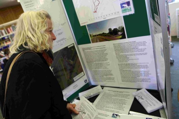 CONTROVERSIAL: Residents look over plans for a traveller site at Oakdale Library