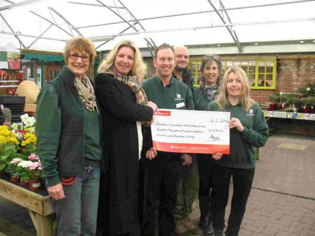 SUPPORT: Jason Carter, Manager at Stewarts Broomhill, with staff members  presenting their cheque for £11,281.57 to Annette Plaistow-Trapaud, Fund Raising Co-ordinator from Dorset and Somerset Air Ambulance