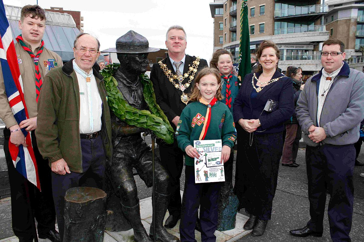 ACCOLADE: Natalie Annels from 1st Lilliput Port Cub Pack with her silver award from district commisioner for Poole Scouts Ragen Bartaby, right