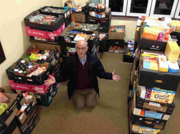 Mark Pearce, chairman of the Kinson Community Food Bank steering committee, with some of the food donated
