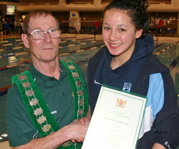 AWARD WINNER: Alice Tai receives her certificate from Gerry Griffin