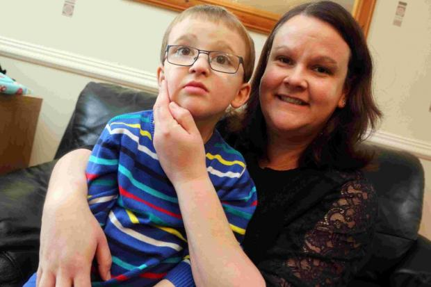 YELLOW DAY: Emma Ellis, with her son Harrison, who suffers from a condition called Global Development Delay