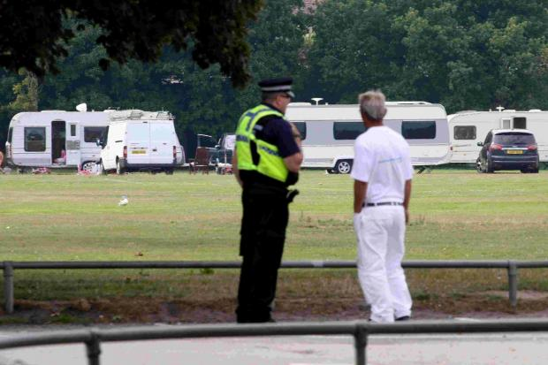 Residents and police watch as travellers move on to Branksome Recreation Ground