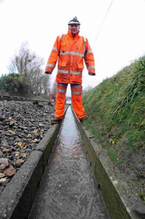 Barry Light inspects the drainage system