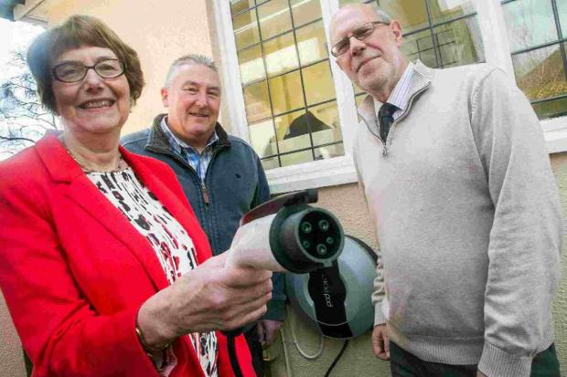 FOOTPRINT: Meridian environmental director Martin Jones, centre, with Annette Brooke MP and husband Cllr Mike Brooke with their new car charging point