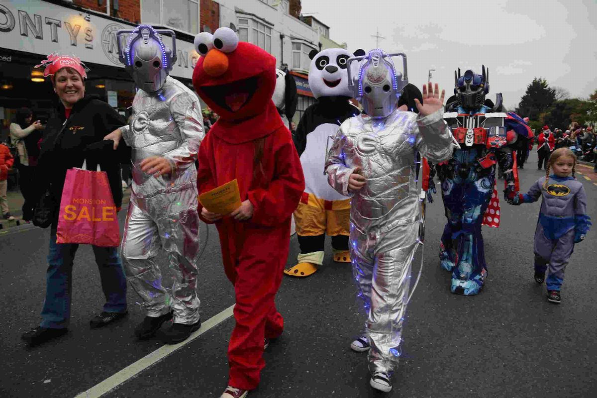 COLOURFUL CHARACTERS: The parade passes through Boscombe.