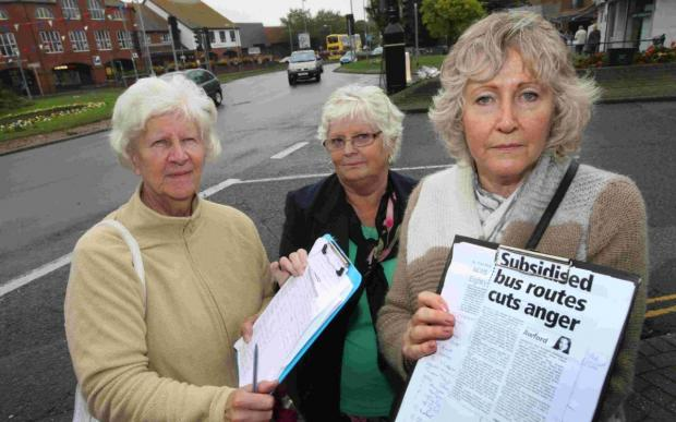 Bournemouth Echo: BUS PROTEST: Burton residents Pam Wyatt, Veronica Renault and Joyce Siegenberg with their petition against the axing of the No.21 bus service