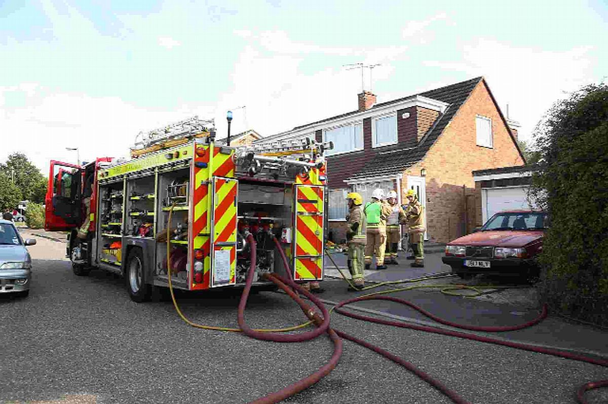 TRAGEDY: Fire crews at the scene of a house fire in Beamish Road, Poole, in which John Applebee died
