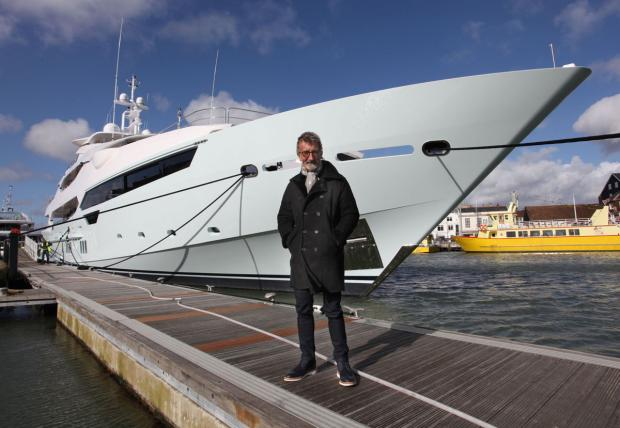 Bournemouth Echo: Eddie Jordan by his new superyacht. Picture Sunseeker/PA.