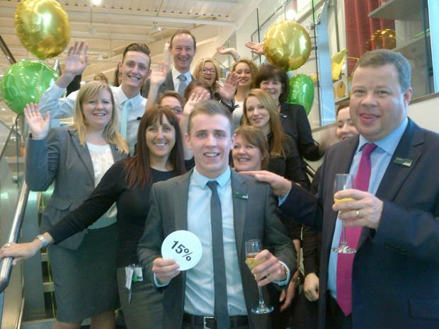 John Lewis at Home Branksome branch manager Jeremy Adams and staff celebrate the announcement of the chain's staff bonus figure