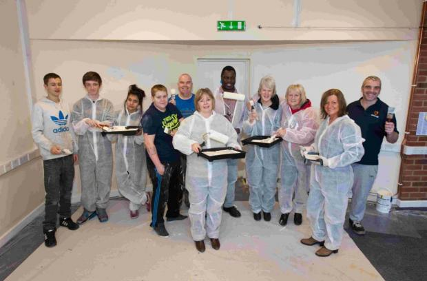 PAINT PARTY: Sovereign staff and members of the community who took part in the paint day at the new Somerford community centre