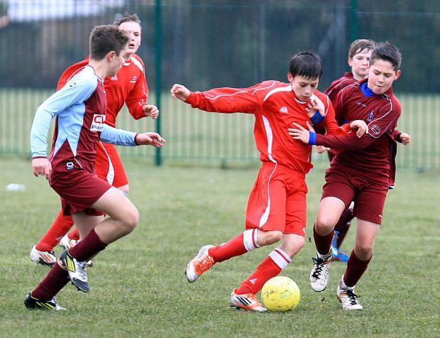 TIGHT TUSSLE: Action from Lymington's 2-0 win over Redhill (purple)