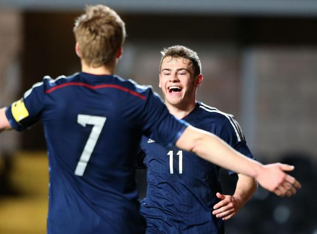 NATIONAL PRIDE: Ryan Fraser celebrates his goal last night