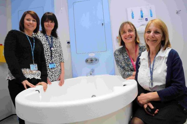 Bournemouth Echo: HAVENLY: The team at the new midwifery unit, midwife Claire White, with support worker Claire Cave, Helen Williams, assistant head of midwifery and Belinda Doe, matron