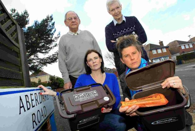 Bournemouth Echo: Pictured with two of the remaining food bins are Redhill residents Nikki Edwards, left, Gordon Harvey, back left, Bob Stocker and Karen Speeden