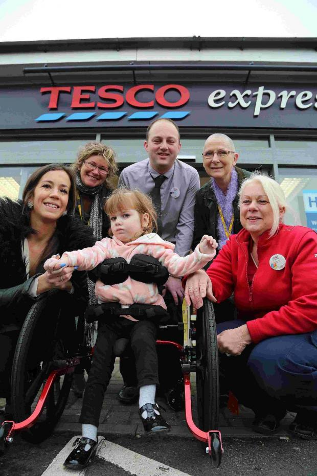 Bournemouth Echo: NEW WALKER: Lexi with mum Emma, Patsy Hallmey and Jayne Hann, second from right,  from the foundation, Tesco manager Matt Holland and grandmother Teresa Dunnings