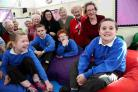 CHILL OUT: Members of the Alma Mater group present £220 worth of cushions and equipment to pupils for their new chill-out room