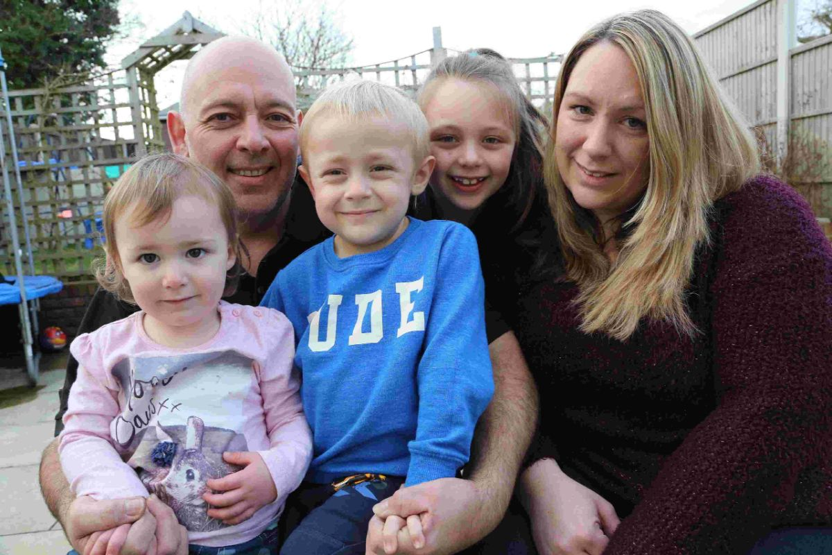 GENEROUS: Lee Atkins, inset below, is raising money for Donna and Barry Holder  son Cameron, four, and daughters Maisie, two, and Ella, seven