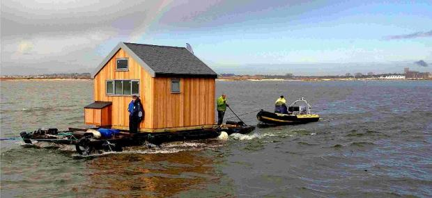 ALL AFLOAT: The new beach hut moves into Mudeford