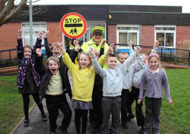 CROSSING A LANDMARK: Children at Merley First School celebrate Jean Witt's 40 years as a crossing patrol officer