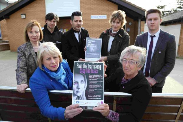 AWARENESS: Front left, Cllr Carol Evans and, front right, Pauline Monk of the Soroptomists at the launch of the poster campaign