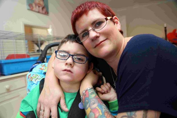 TAKING CARE: Gemma Conyard with her disabled son, Patrick