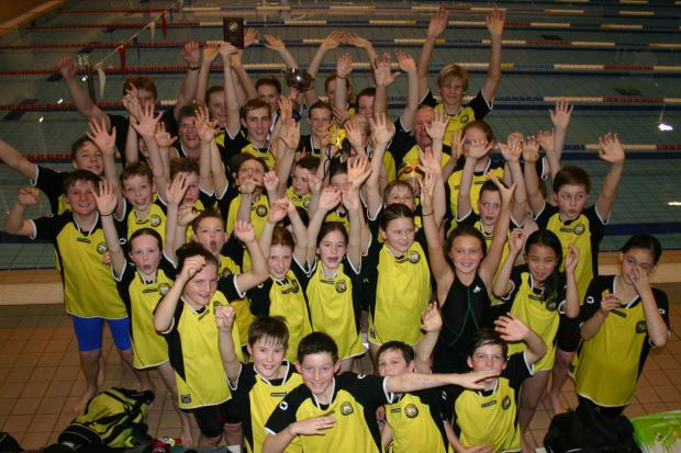 JUBILANT: Poole Swimming Club celebrate their success