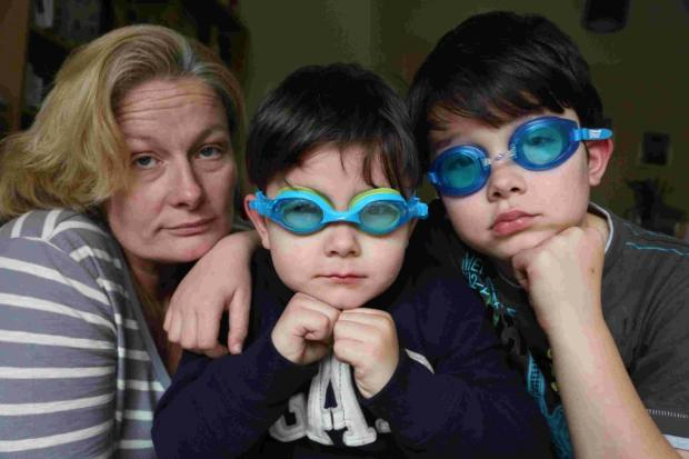 SPLASH: Andrea Potts-Pointer with her sons Alex, 8, and Aiden, 4