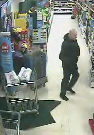 UPDATE: Police release CCTV images of alleged attempted robbery at Tesco by man 'armed with a pole'