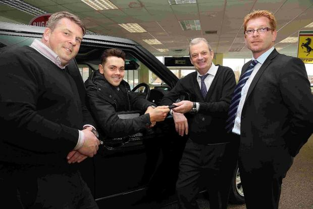 Bournemouth Echo: WHEEL DEAL: Ray Quinn picks up his new Range Rover at Car Link from Andy Toy, garage owner Alan Fisher and Jonathan Hall